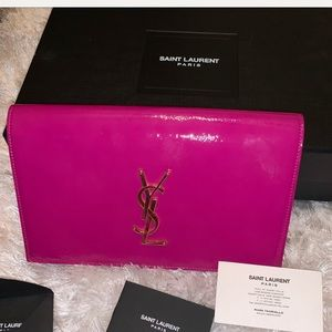 Pink YSL patent leather clutch